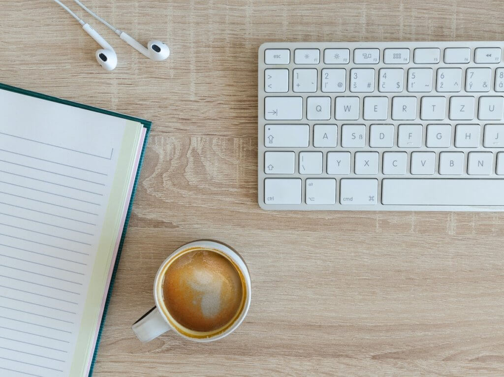 blogging on a keyboard with coffee
